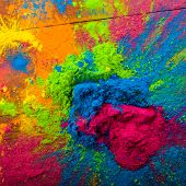 Bright colours on sawed wood for Indian holi festival. Colorful gulal (powder colors) for Happy Holi poster