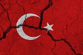 Turkey Flag On The Cracked Earth. National Flag Of Turkey. Earthquake Or Drought Concept poster