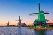 Netherlands rural lanscape - windmills at famous tourist site Zaanse Schans in Holland. Zaandam, Net poster