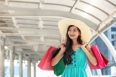 Asian Smiling Lifestyle Woman So Happy Shopping In Casual Clothing With Shopping Bags In The Model T poster