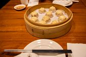 Chinese Steamed Steamed Bun ( Baozi ) Named Xiaolongbao Also Called A Soup Dumpling. It Is Tradition poster