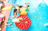 High Angle View Of Millenial Friends Jumping At Swimming Pool Party - Youth Vacation Concept With Ha poster