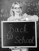 Top Ways To Welcome Students Back To School. Teacher Woman Hold Blackboard Inscription Back To Schoo poster