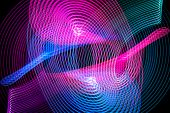 Abstract Rainbow Blue And Pink Neon Glowing Crossing Lines Pattern. Dark  Background Of Colorful Neo poster