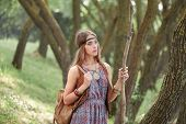 Young Hippie Woman With A Bag Walking Through The Woods poster