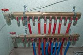 Radiant Floor Heating Installation Heating System. Man Install Underfloor Water Heating Floor Constr poster
