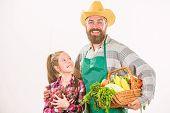 Farmers Family Homegrown Harvest. Father Farmer Or Gardener With Daughter Hold Basket Harvest Vegeta poster