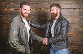 Brutal Bearded Men Wear Leather Jackets Shaking Hands. Real Men And Brotherhood. Strong Handshake. F poster