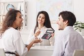 Buying Tour. Travel Agent Showing Tour Value On Calculator To Couple poster