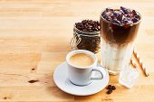 Cup Of Coffee Or Espresso, Iced Coffee And Latte Macchiato In Tall Glass With Straws On Wooden Table poster
