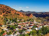 Town Of Bisbee With Surrounding Mule Mountains In Arizona. This Historic Mining Town Was Built Early poster