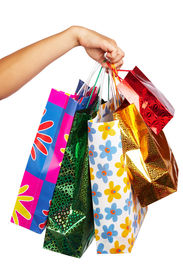 stock photo of holding money  - woman hand with shopping bags - JPG