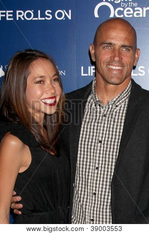 LOS ANGELES - NOV 11:  Kalani Miller, Kelly Slater arrives at the Life Rolls On Foundation's 9th Annual Night By The Ocean at The Ritz-Carlton on November 11, 2012 in Marina del Rey, CA