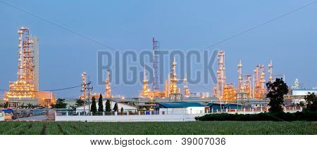 Panorama Architecture of Oil Refinery Plant with distillation tower at dusk