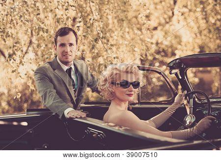 Retro couple and convertible