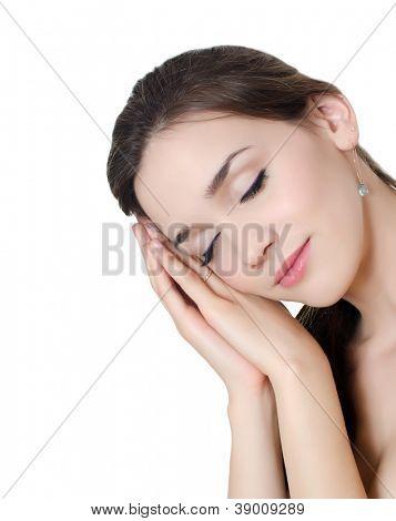 Portrait of beautiful girl sleeping on hands