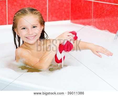 Little girl in the bath with a red wisp