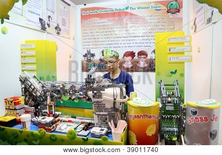 SUBANG JAYA - NOVEMBER 10: A complex robot made by unidentified student from Thailand selects, prepares and serve tea in cups at the World Robot Olympaid on November 10, 2012 in Subang Jaya, Malaysia.