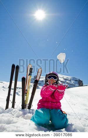 Winter fun, ski, snow and sun - lovely skier girl enjoying the snow