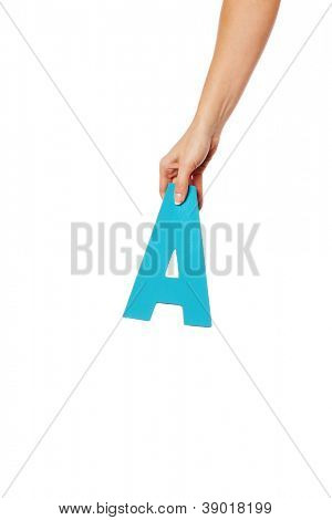 Female hand holding up the uppercase capital letter A isolated against a white background conceptual of the alphabet, writing, literature and typeface