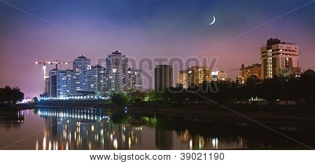 Krasnodar city in night with reflection in water