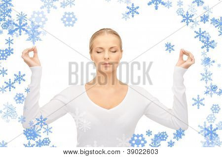 bright picture of woman in meditation over white.
