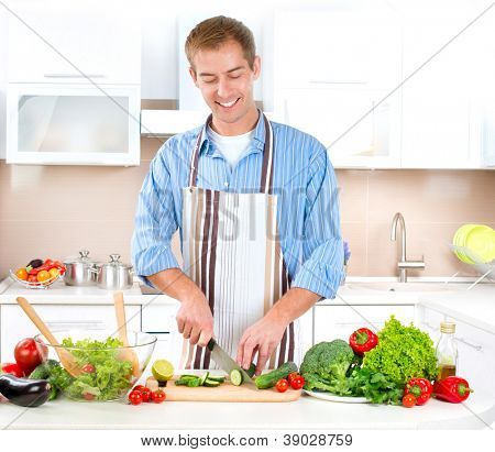 Young Man Cooking. Healthy Food - Vegetable Salad. Diet. Dieting Concept. Healthy Lifestyle. Cooking At Home. Prepare Food