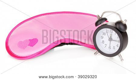 Sleeping mask and alarm clock isolated on white