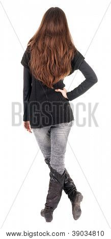 back view of standing young beautiful  woman.  blonde girl in jeans and sweater watching;. Rear view people collection.  backside view of person.  Isolated over white background.