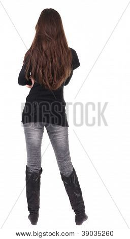 back view of standing young beautiful  woman.  brunette girl in red sweater watching;. Rear view people collection.  backside view of person.  Isolated over white background.