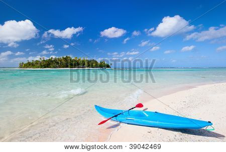 Kayak on an exotic pink sand beach overlooking small island