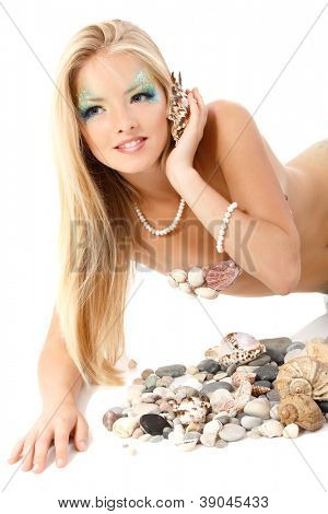 portrait of beautiful blond mermaid calling phone with shell isolated on white background
