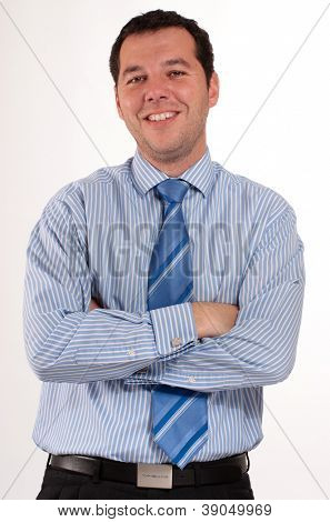 Man in his 30�¢??s wearing a blue stripped shirt and tie