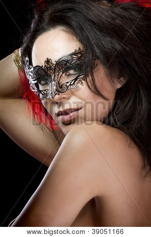 Sexy woman with  venetian mask, red light at background