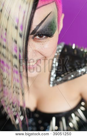Smiling woman with multicoloured hair and spike dress