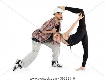 Ballerina in black put her foot on head of man and breakdancer in helmet holds her hand and rolls his eyes isolated on white background.
