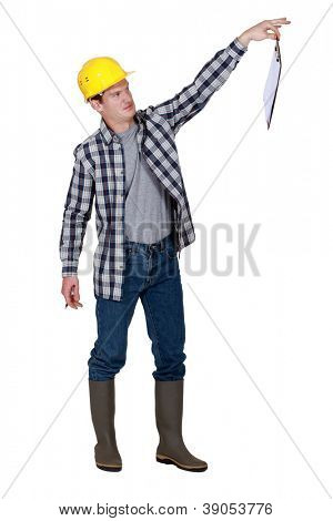 A repulsed tradesman dangling a clipboard