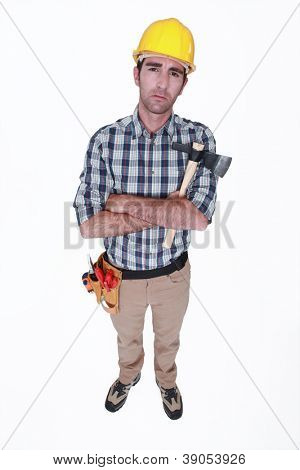 Grumpy tradesman holding a hatchet