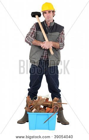 Man stood by box full of waste