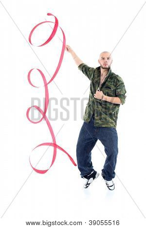 Rapper in camouflage jacket with ribbon stands on tiptoes isolated on white background.
