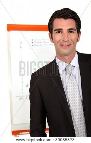 portrait of young businessman making presentation during meeting