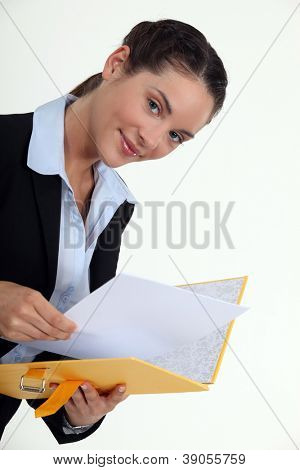 Woman holding yellow folder