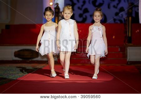 MOSCOW - JAN 26: Little girls walk the runway during children fashion show Stillini Ball of Colours, New Collection 2012-2013 in banquet hall Place de Paris at Korston Hotel, Jan 26, 2012, Moscow, Russia