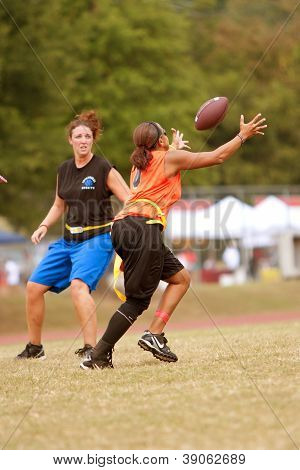 Female Flag Football Player Catches A Pass