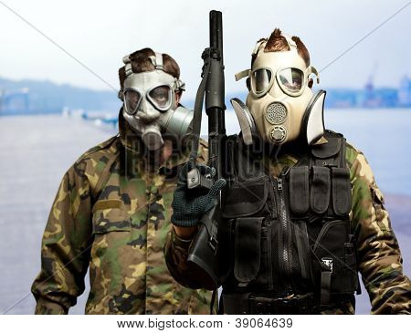 Portrait Of Soldiers With Gun And Gas Mask, Outdoor