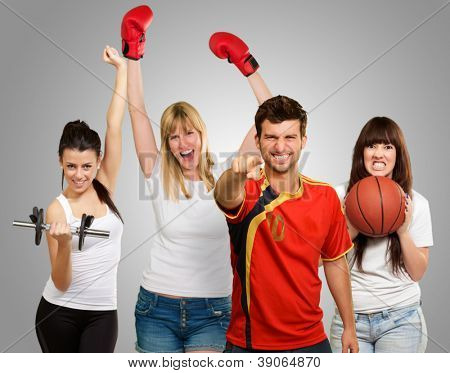 Group Of Sporty People Isolated On Gray Background