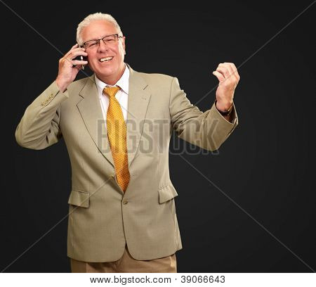 Senior Business Man Talking On Phone Isolated On Black Background