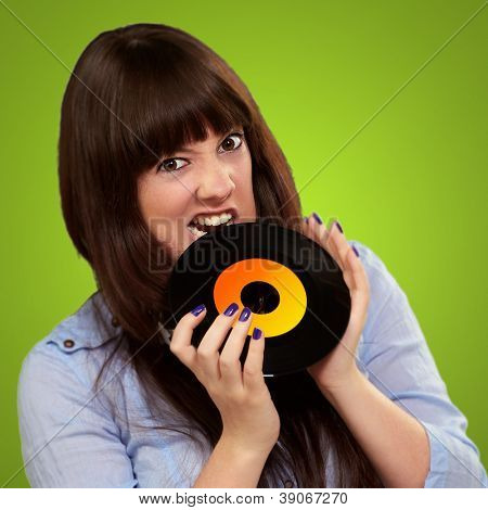 Young Girl Baiting Vinyl On Green Background
