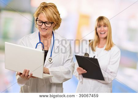 Portrait Of Two Happy Female Doctors, Indoors