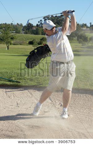 Golfer In Sand Bunker